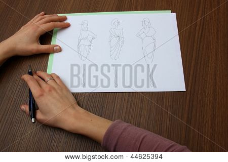 Designer Assessing Fashion Drawings