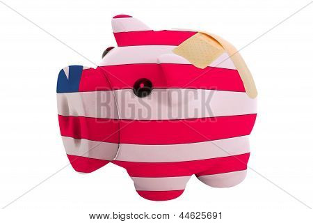 Closed Piggy Rich Bank With Bandage In Colors National Flag Of Liberia