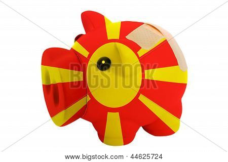 Closed Piggy Rich Bank With Bandage In Colors National Flag Of Macedonia