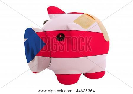 Closed Piggy Rich Bank With Bandage In Colors National Flag Of Puertorico