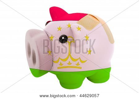 Closed Piggy Rich Bank With Bandage In Colors National Flag Of Tajikistan
