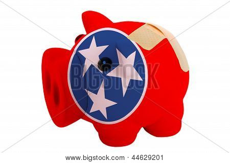 Closed Piggy Rich Bank With Bandage In Colors Flag Of American State Of Tennessee
