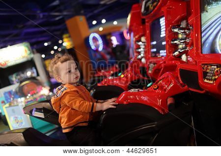 Boy On Amusement Bike