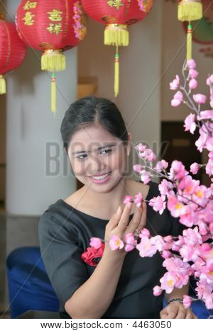 Asian Girl With Chinese Lampion And Sakura Flower