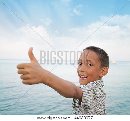 Boy Showing Thumbs-up Against Sea