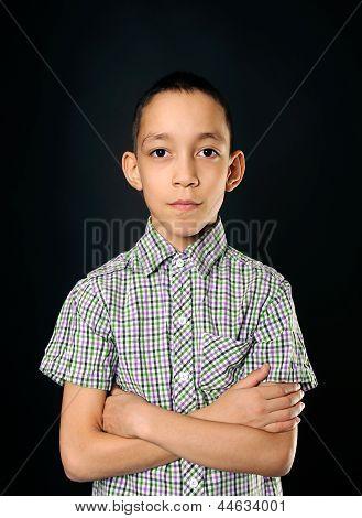 Calm Young Boy Looking At Camera