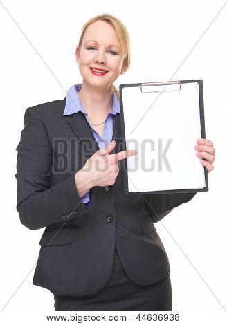 Portrait Of A Happy Businesswoman Pointing To Empty Sign Clipboard