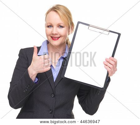 Portrait Of A Businesswoman Showing Empty Sign Clipboard With Thumbs Up