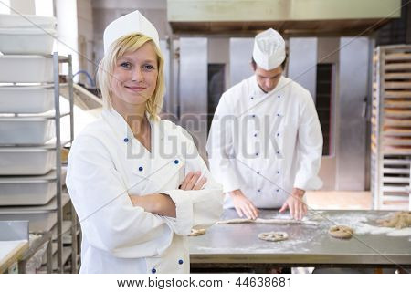 Baker Posing In Bakery Or Bakehouse