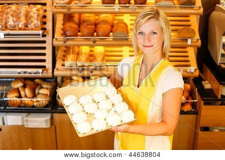 Bakery Shopkeeper Presents Meringue