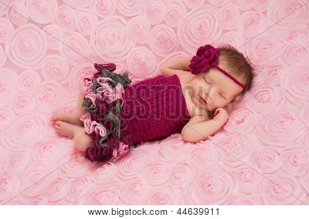 Newborn Baby Girl Wearing a Crocheted Romper