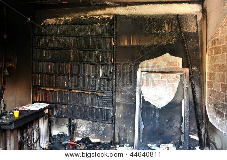 Burned books and furniture after a house fire