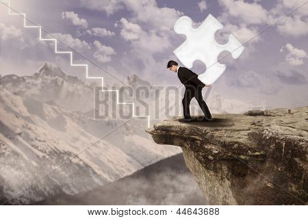 Businessman Walk Up Carrying Puzzle