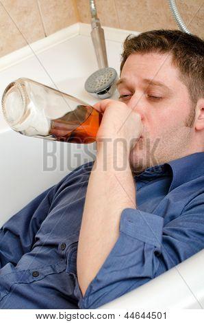 Drunk Man Drink Alcohol Lying In Bath