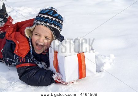 Happy Boy In The Snow With A Box Of Snowballs