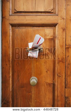 Magazines In A Letterbox Of A Door