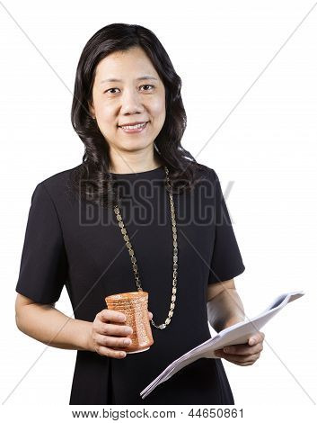 Mature Asian Woman In Business Attire With Report And Coffee Cup In Hand