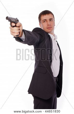 A man holding a gun in the hands