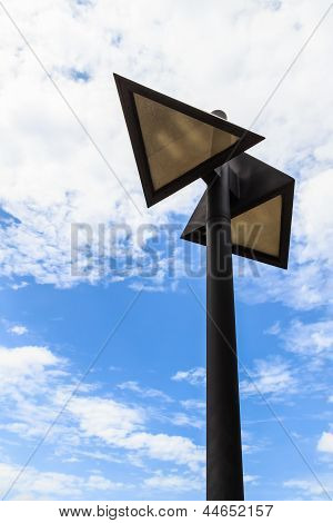 Triangle-shaped Street Lamp Against White Cloud And Blue Sky