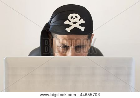 a hacker watching confused his notebook over white background