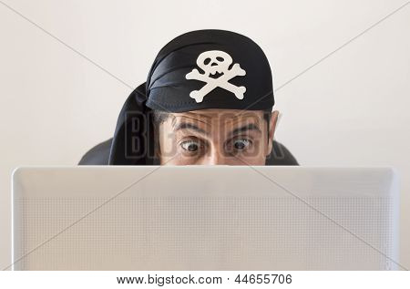 hacker watching surprised his notebook over white background