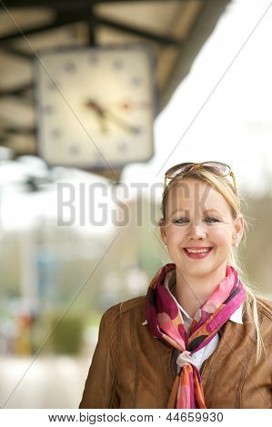 Beautiful Mature Woman Smiling Under Train Station Clock