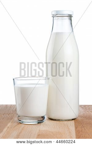 Bottle Of Fresh Milk And Glass Is Wooden Table Isolated On White Background