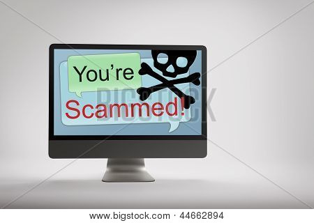 Computer Displaying Fraud And Scam Warning On Screen