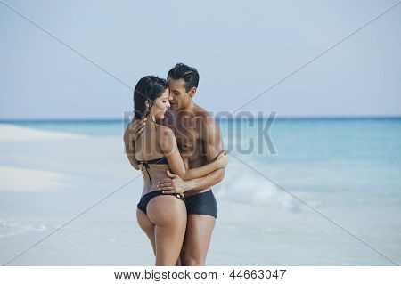 Couple romancing on the beach