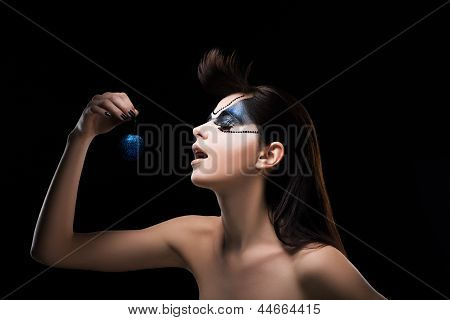Fantasy. Image Of Fancy Woman Holding A Blue Ball In Hand. Inspiration
