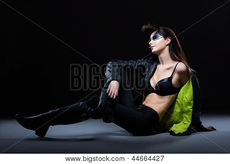 Fashion. Ultramodern Glamorous Woman Sitting In Modern Clothing. Daydream