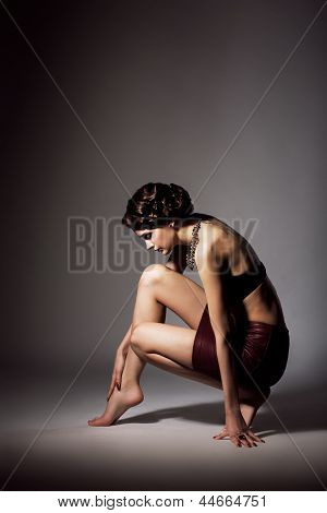 Femininity. Voluptuous Barefoot Pensive Woman Sitting On Tiptoe. Grace