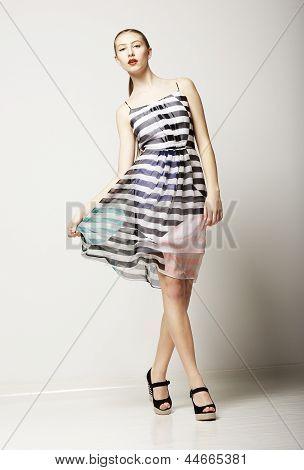 Lifestyle. Attractive Slim Female Wearing Sleeveless Tabby Dress. Sensuality