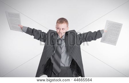 Boy Waving Papers