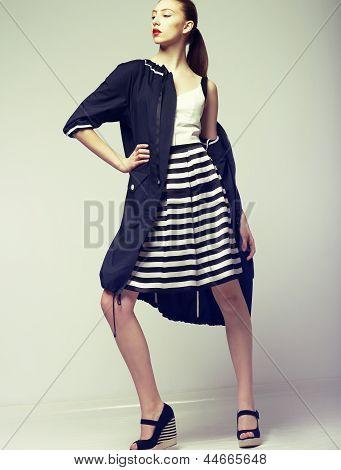 Tendency. Beautiful Fashion Model In Outwear. Elegance