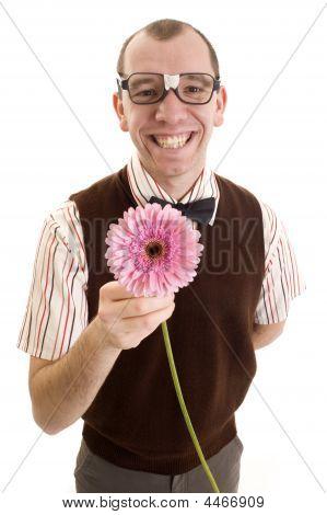 Smiling Nerd Offering A Flower.