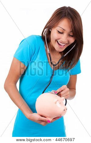 Young Happy Beautiful Asian Woman Using Stethoscope On Her Piggy Bank - Asian People