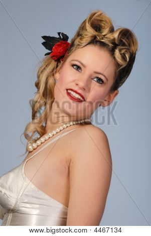 Beautiful Retro Fifties Blond Girl With Victory Rolls