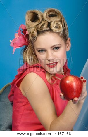 Fifties Pinup Girl Tempts You With An Apple