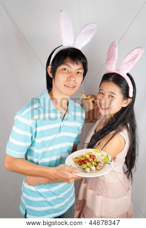 Asian Bunny Lovers Hold Easter Eggs  Pierced.