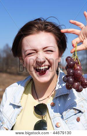 Girl Eating Grapes