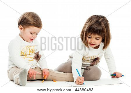 Two Baby Sisters Drawing Together.