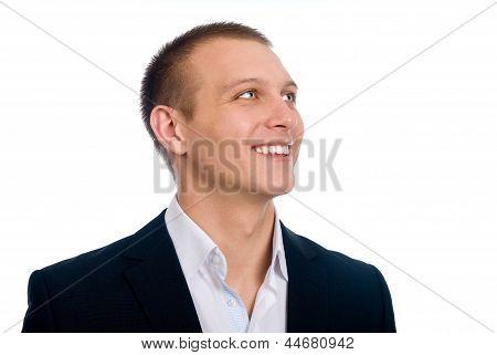 Close-up Portrait Of A Happy Successful Businessman. Looks Aside.