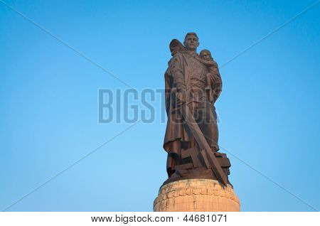 Statue of soviet soldier holding a child that he saved and stepping on swastiks