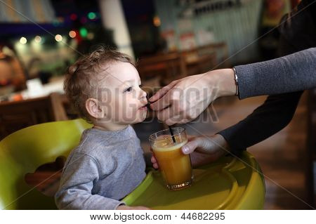 Toddler Drinks Juice