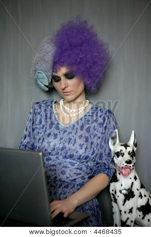 Fashion Woman With Computer And Dalmatian Dog