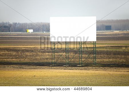 Empty advertisement board next to a highway