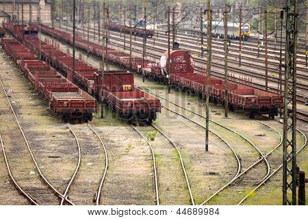 Old, rusty freight wagons on the railway