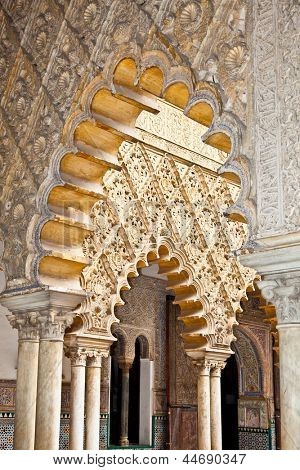 Mudejar decorations in the Patio de las Doncellas (Courtyard of the Maidens) from Peter the first Palace in the Royal Alcazars of Seville, Spain.