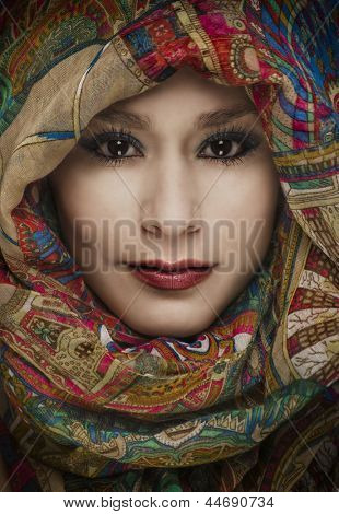 Beautiful woman wearing colorful head scarf